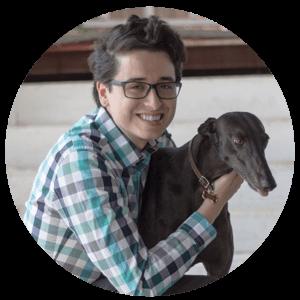 Cedric Chambers posing with dog coco.